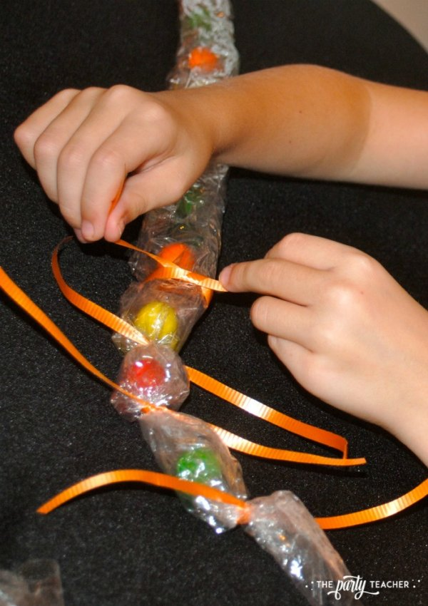 Sweet Not Spooky Halloween Party by The Party Teacher-making candy necklaces 2