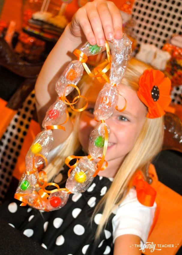Sweet Not Spooky Halloween Party by The Party Teacher-making candy necklaces 3
