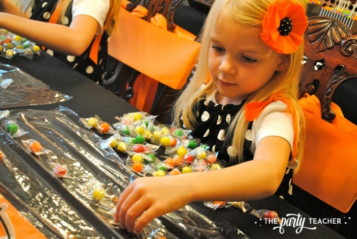 Sweet Not Spooky Halloween Party by The Party Teacher-making candy necklaces