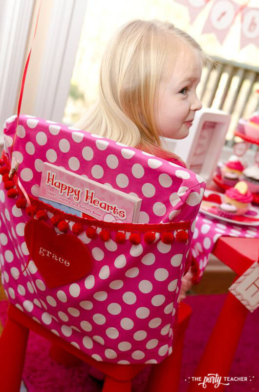 Valentine's Day Party by The Party Teacher - chair cover with party favors