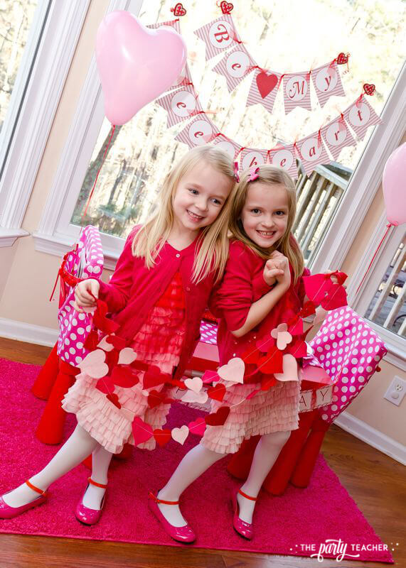 Valentine's Day Party by The Party Teacher - girls with felt hearts banner