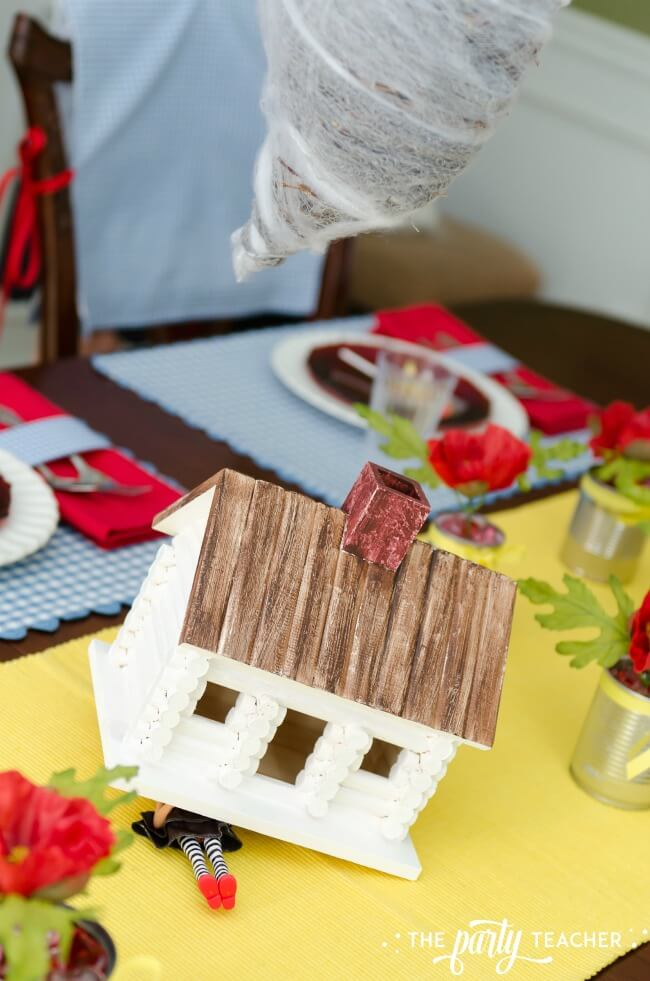 Wizard of Oz party by The Party Teacher - Gale farmhouse and tornado centerpiece