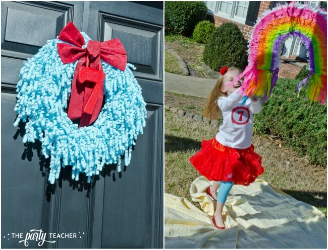 Wizard of Oz party by The Party Teacher - blue gingham door wreath and rainbow pinata