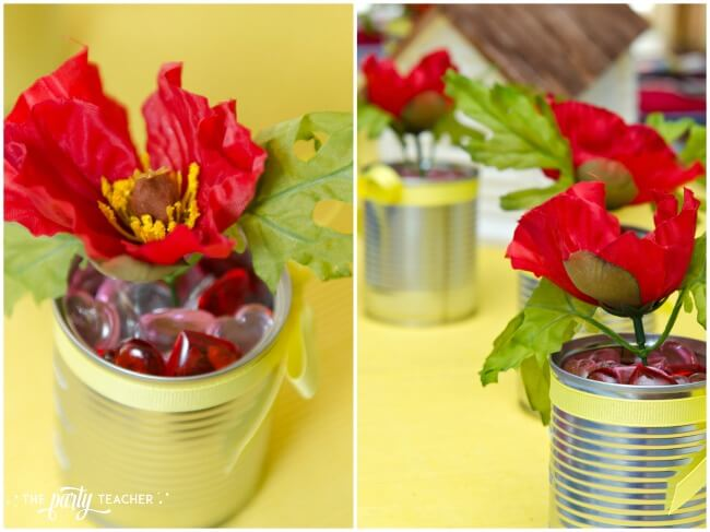 Wizard of Oz party by The Party Teacher - poppy tin man centerpieces