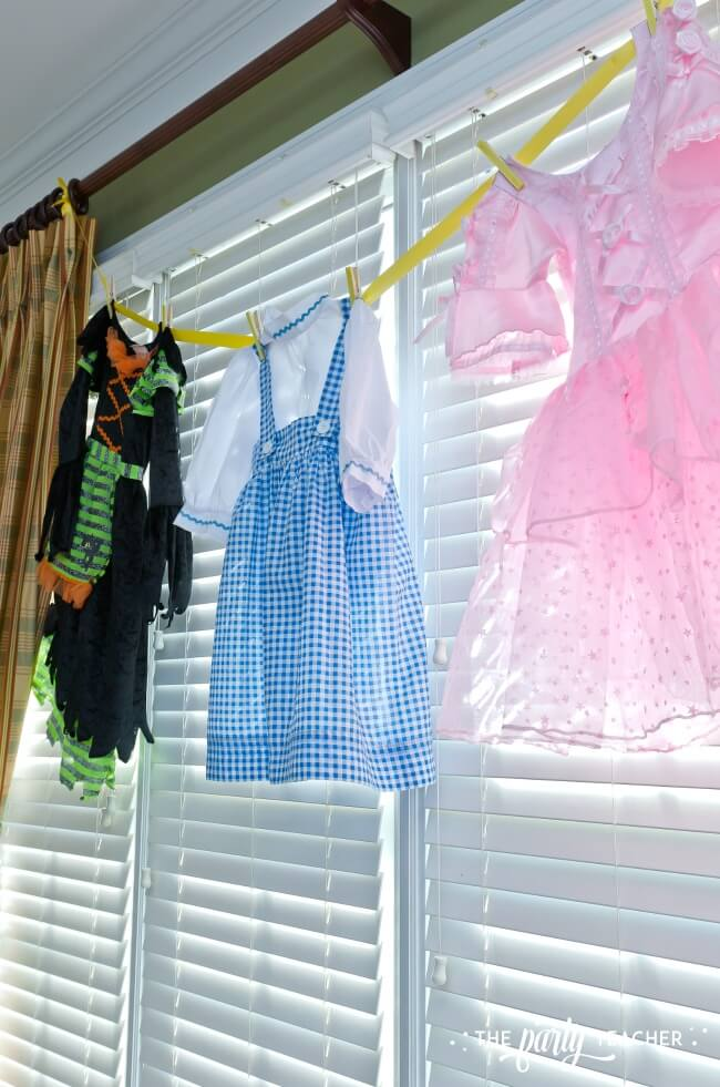 Wizard of Oz party by The Party Teacher - use Halloween costumes as decoration