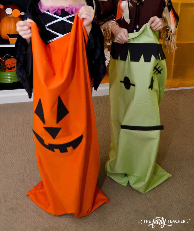 Halloween trick or treat party by The Party Teacher - monster sack races