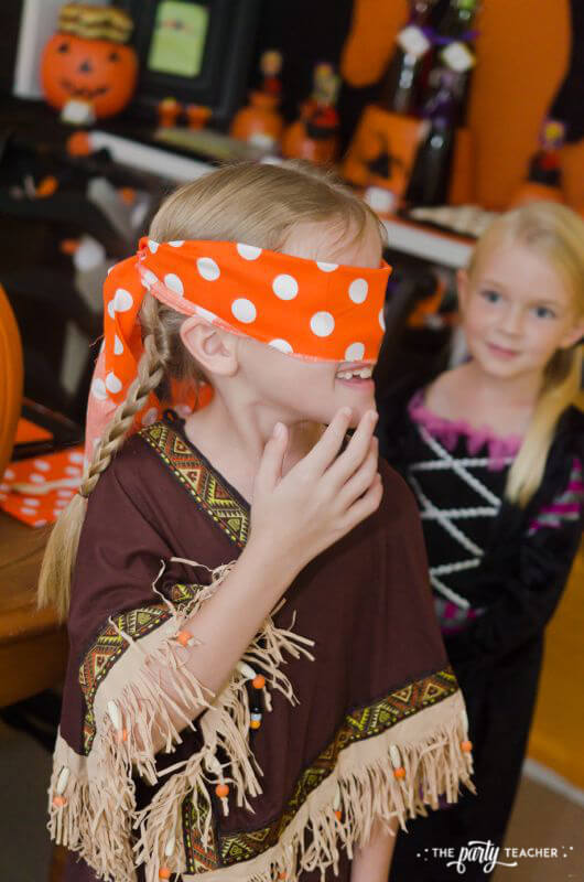 Halloween trick or treat party by The Party Teacher - pin face on pumpkin mask