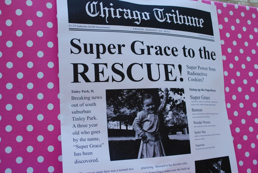 Girl's superhero birthday party - newspaper backdrop