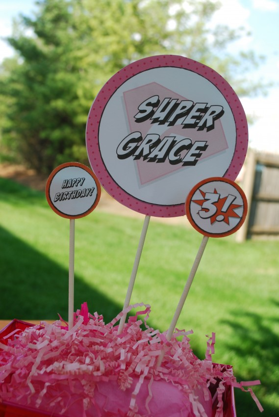 Girl's superhero birthday party - printables as centerpieces