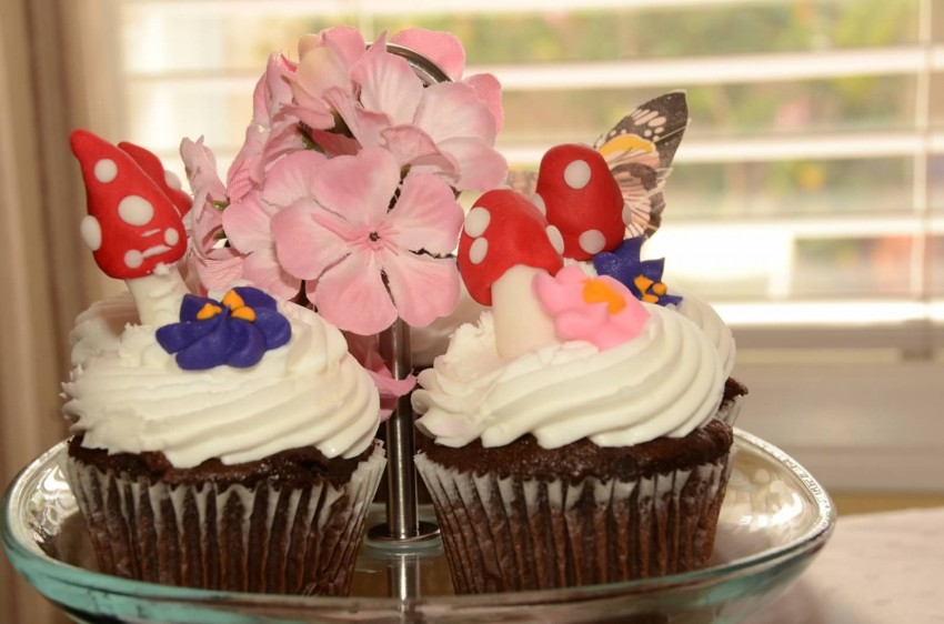 Woodland fairy birthday party by Ritzy Parties featured on The Party Teacher - toadstool cupcakes
