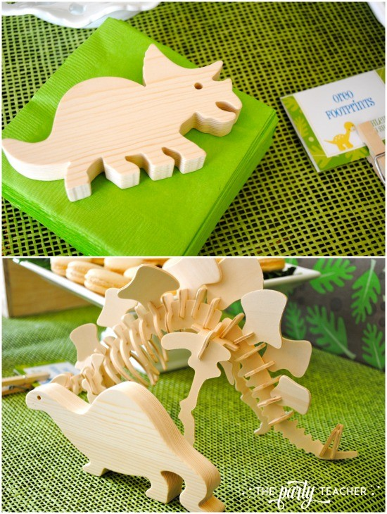 Dinosaur baby shower by The Party Teacher - wood dinosaur toys as party decor