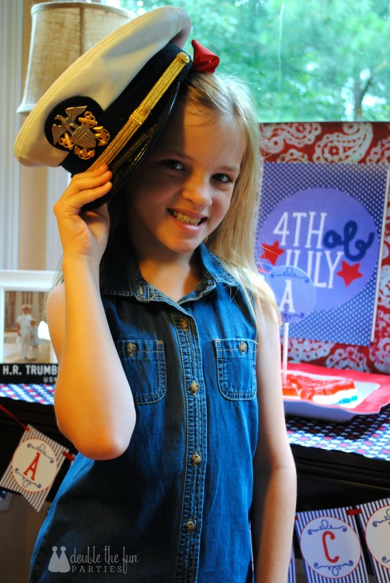 4th of July Party wearing her grandfather's navy hat by Double the Fun Parties-WM