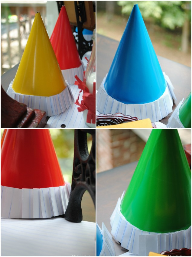 Back to school party hats trimmed with lined school paper by Double the Fun Parties