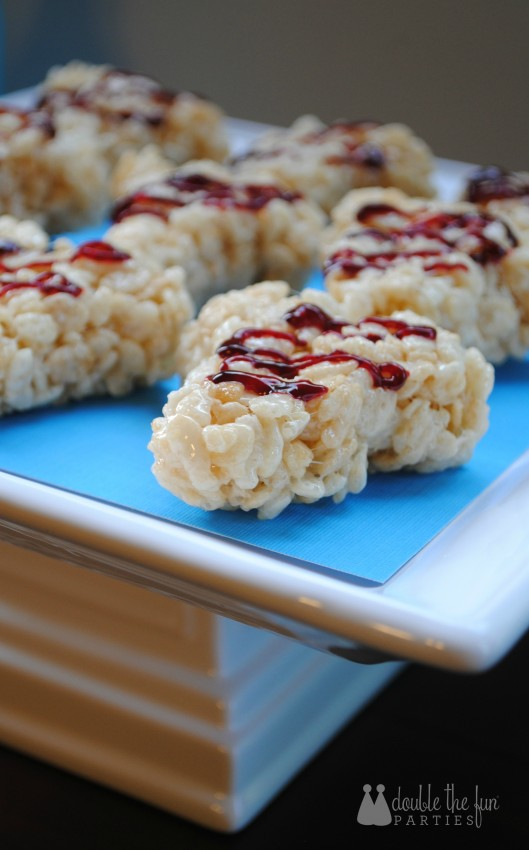 Shark party Rice Krispies Treats in the shape of a shark tooth by Double the Fun Parties
