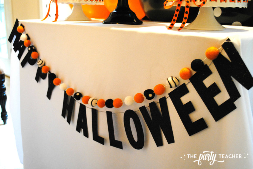 Pumpkin Decorating Halloween Party by The Party Teacher - glitter banner
