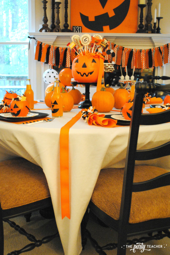 Pumpkin Decorating Halloween Party by The Party Teacher - ribbon on dining table