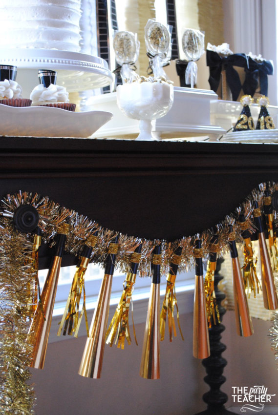 New Year's Eve Family Movie Night by The Party Teacher - party horn garland
