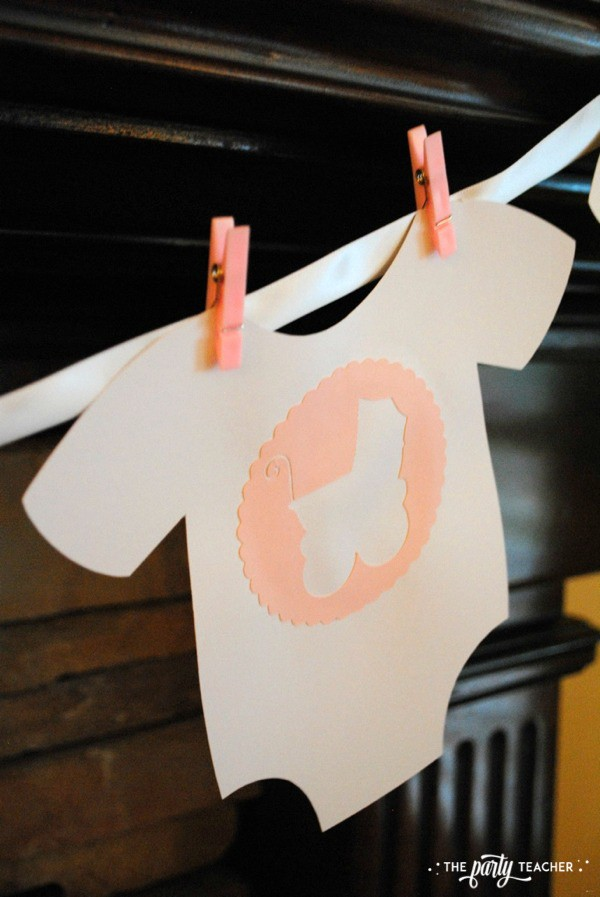 Baby carriage inspired baby shower by The Party Teacher - onesie banner