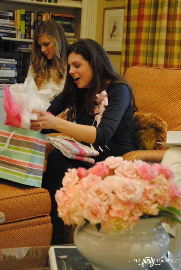 Baby carriage inspired baby shower by The Party Teacher - opening gifts