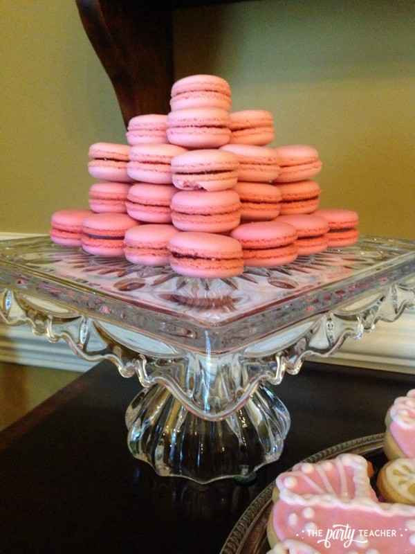 Baby carriage inspired baby shower by The Party Teacher - pink ombre macarons
