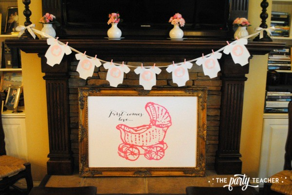 Baby carriage inspired baby shower by The Party Teacher - mantle