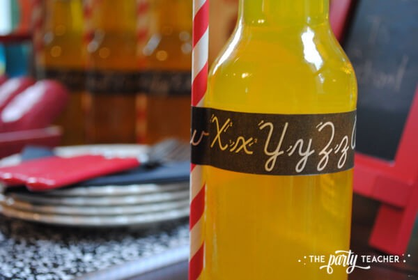 Back to school party by The Party Teacher - cursive tape on soda bottle