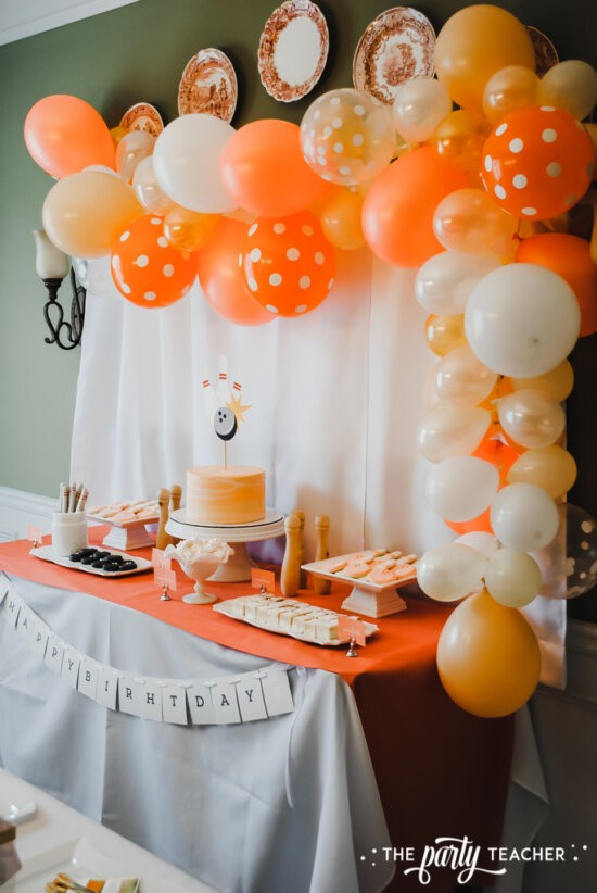 Teen Girls Bowling Party by The Party Teacher - balloon garland over dessert table