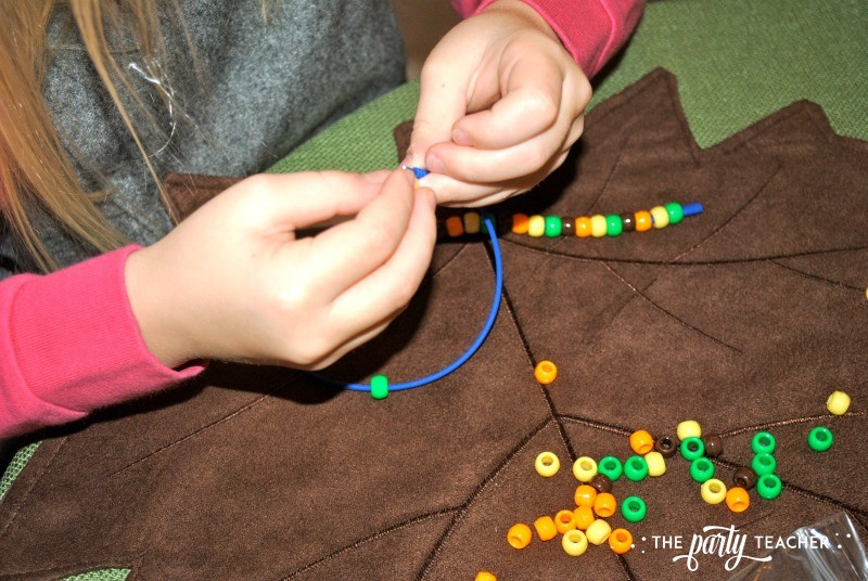 Make pony bead necklaces in fall colors - The Party Teacher