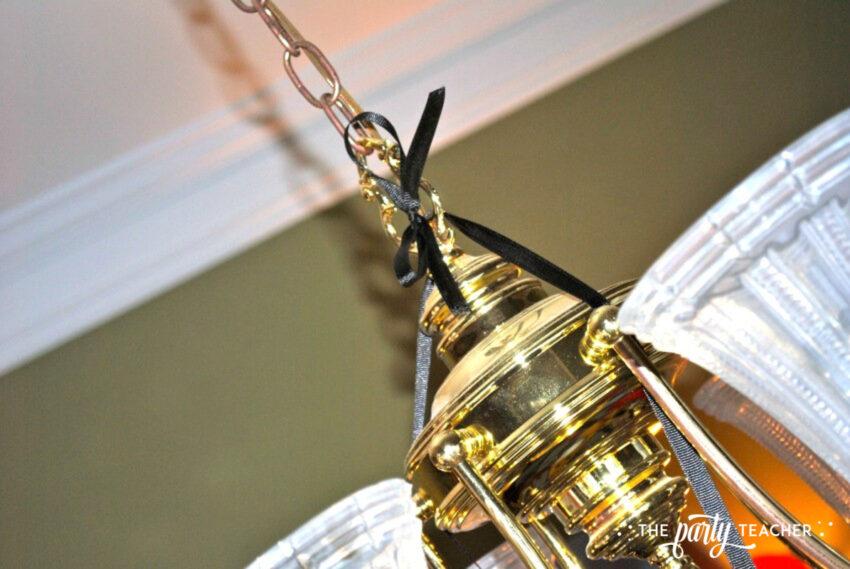Wizard of Oz tornado tie to chandelier - The Party Teacher