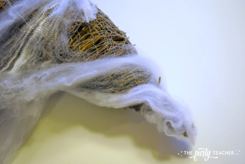 Wizard of Oz tornado wrap spider webbing - The Party Teacher