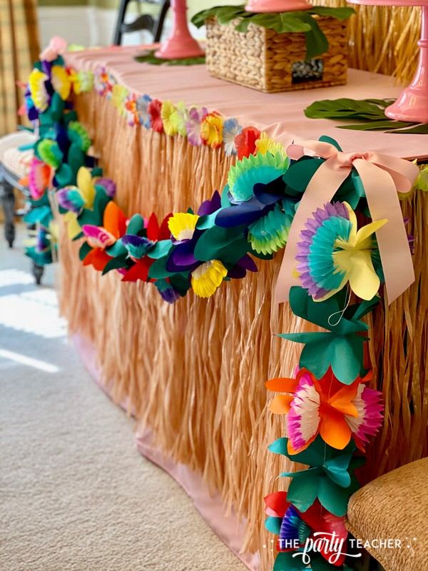 Donut Hut birthday party by The Party Teacher - tissue flower garland