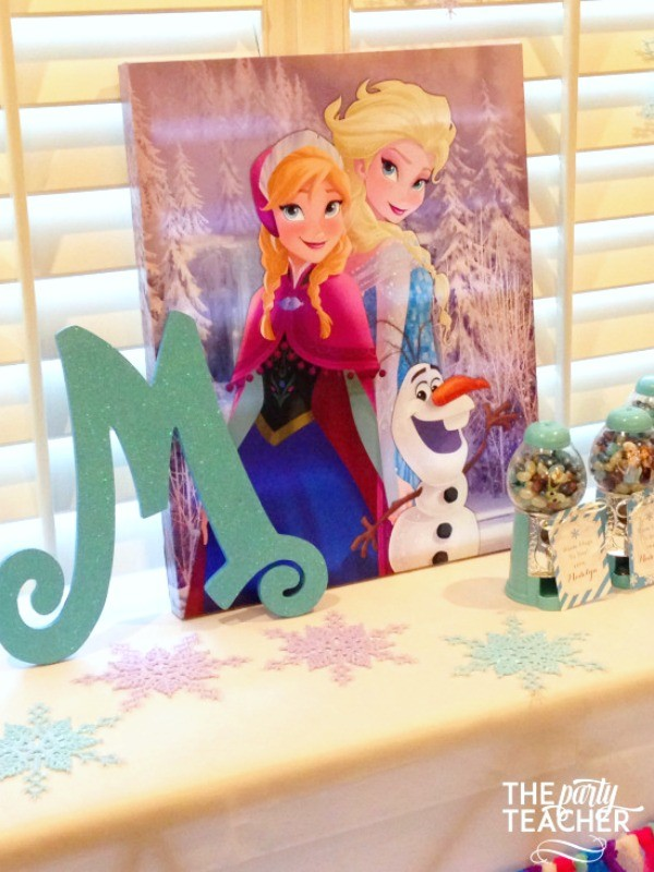 Frozen-Party-on-a-Budget-favor table backdrop-The Party Teacher
