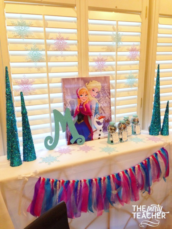 Frozen-Party-on-a-Budget-favor table snowflake backdrop-The Party Teacher