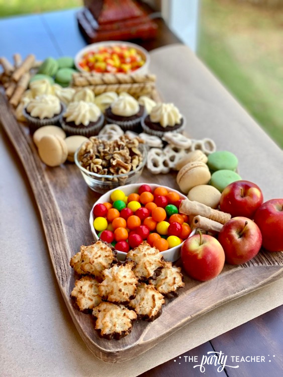 How to Make an Easy Thanksgiving Charcuterie Board - The Party Teacher-add nuts macarons